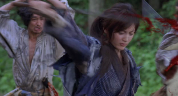 Slash slash slash slash slash...blind girl owns everyone in an awesome slowed-down fight scene.